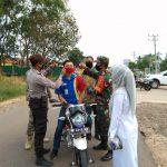 Tim Gabungan Koramil 427-01/PKR Himbau masyarakat Gunakan Masker