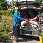 Babinsa Desa Sabah Balau Peltu E. Yurizal : Sumbang semen Untuk Pembangunan Balai Desa Setempat.